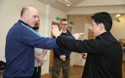 Martial Arts Teacher instructing student